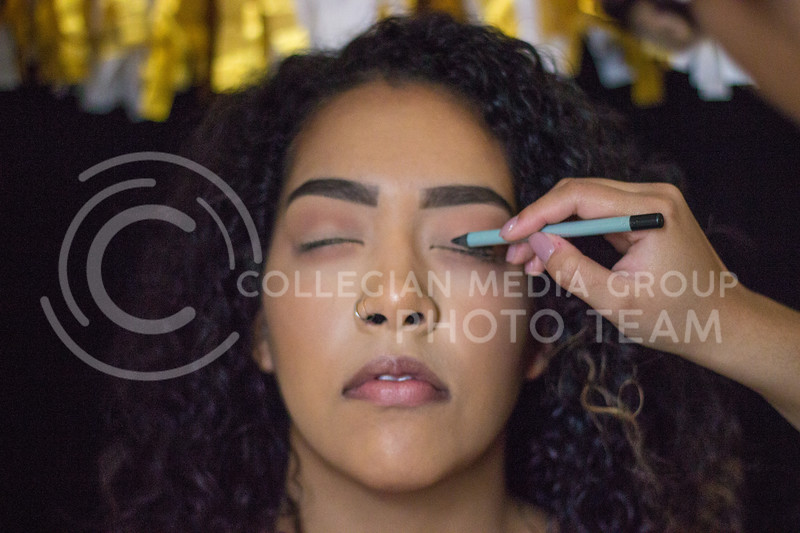 Isabelle McCoy helps demonstrat a step by step New Years Eve makeup tutorial on November 10th, 2017. ( Kelly Pham | Collegian Media Group)