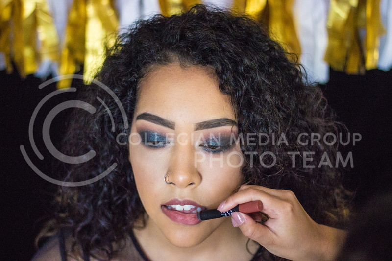 Isabelle McCoy helps demonstrat a step by step New Years Eve makeup tutorial on November 10th, 2017. ( Kelly Pham   Collegian Media Group)