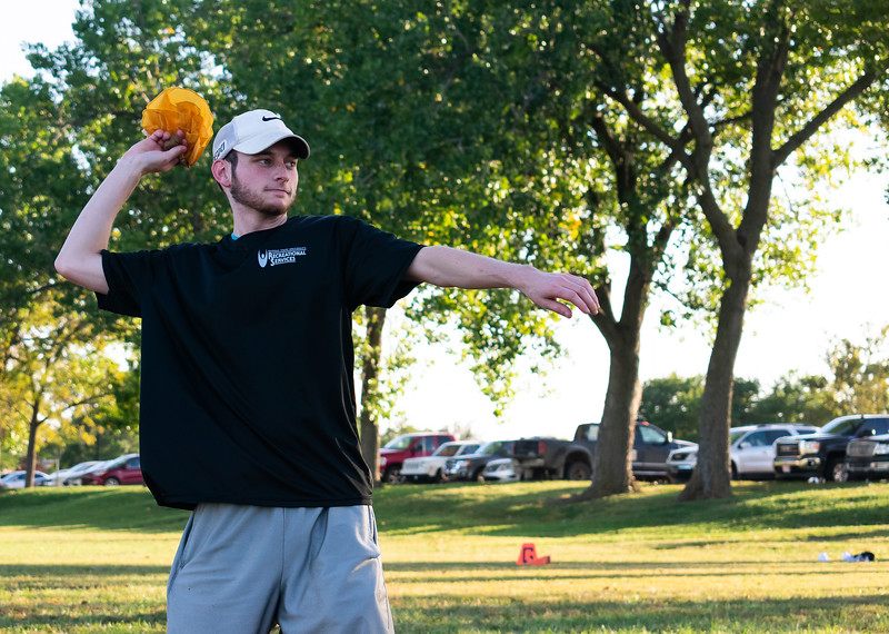 Andrew Haines, a senior in financial management, throws a flag across the field during an intramural flag football game at the Chester E. Recreation Complex. Haines enjoyed meeting many employees and players throughout the three years he worked as a referee at K-State. His favorite sport to ref was basketball where he could experience intense last-second winning shots. (Brooke Barrett | Collegian Media Group)