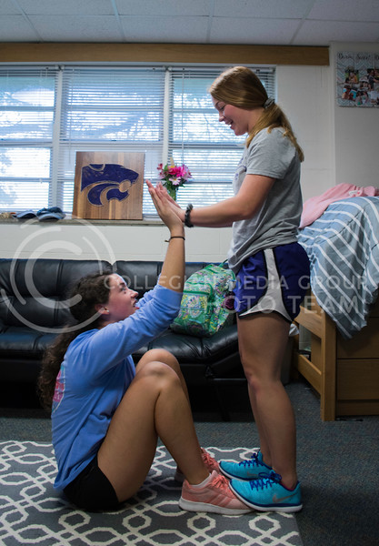 Alexis Hoskinson, a Freshman studying Chemical Engineering, holds down the feet of her room mate Erin Kellerman, a Freshman studying Pre-Nursing, as she does a sit-up in thier dorm. Haymaker Hall, Kansas State University, Manhattan Kansas, Sept. 18, 2017. (Olivia Bergmeier | Collegian Media Group)