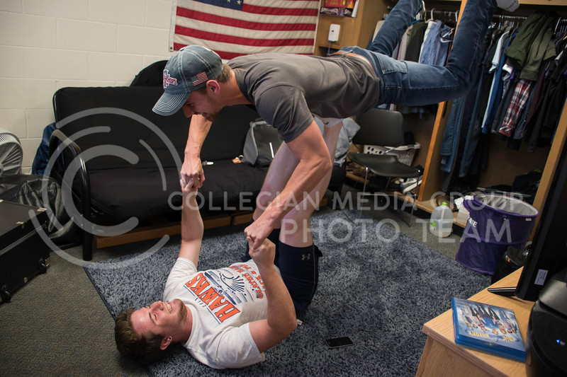 "James Evans, a Freshman in Open Option, holds up his room mate, Tyler Heidebrecht, a Freshman studying Construction Science, in what is called ""Partner Yoga"". Haymaker Hall, Kansas State University, Manhattan KS, Sept. 18, 2017. (Olivia Bergmeier | Collegian Media Group)"