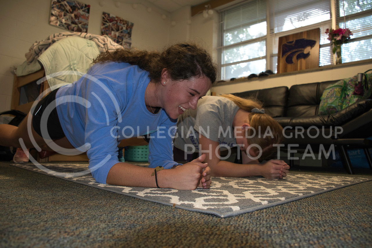 Erin Kellerman, a Freshman at Kansas State studies Pre-Nursing, and loves to keep up on her fitness. Erin and her room mate, Alexis, do a plank together on their dorm room floor. Haymaker Hall, Kansas State University, Manhattan Kansas, Sept. 18, 2017. (Olivia Bergmeier | Collegian Media Group)