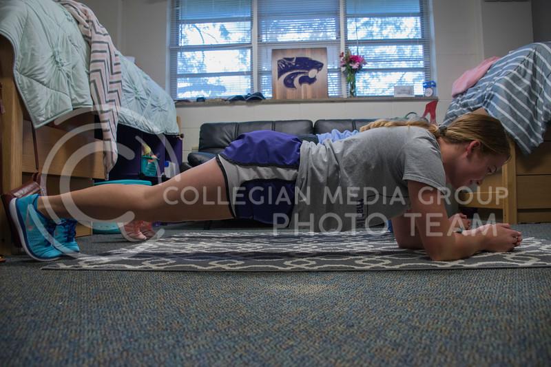 Alexis Hoskinson, a Freshman at Kansas State studying Chemical Engineering, does a plank on her dorm room floor next to her roomate, Erin Kellerman. Haymaker Hall, Kansas State University, Manhattan Kansas, Sept. 18, 2017. (Olivia Bergmeier | Collegian Media Group)