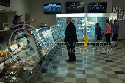 Eli Neal assists a customer at the Manhattan Meat Market in Manhattan, Kan. on June 23, 2017. The Manhattan Meat Market is a local specialty meats and artisan butcher shop. (Justin Wright | The Collegian)