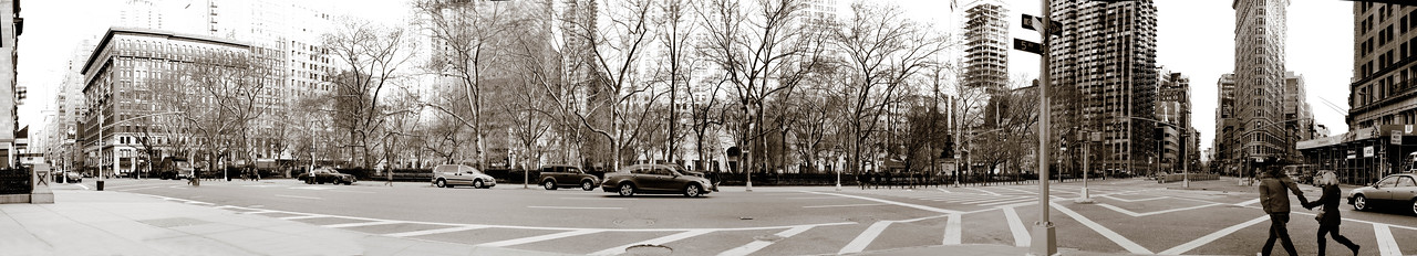 A panoramic view of 5th Avenue and the west side of Madison Square Park.