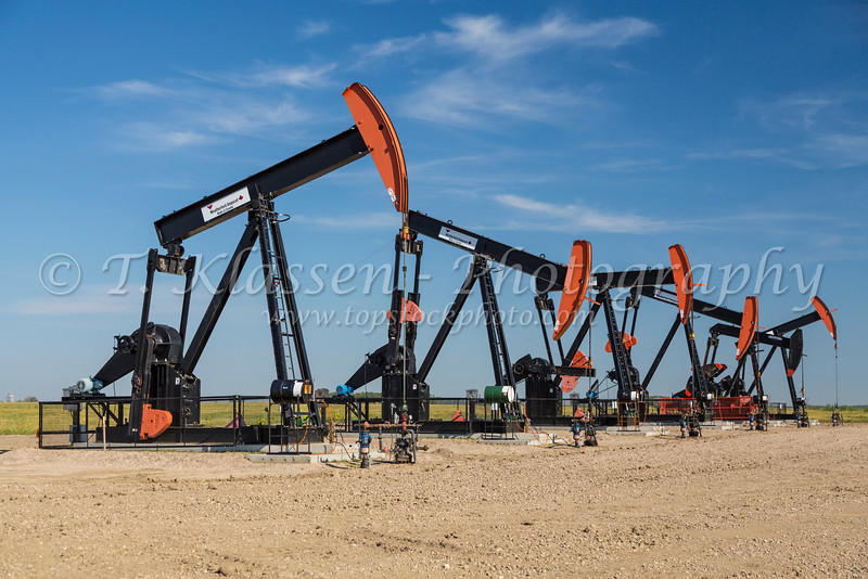 Oilfield pumpers on the prairies near Coulter, Manitoba, Canada.