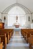 The Ste. Thérèse Catholic Church interior sanctuary in Cardinal, Manitoba, Canada.