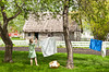 A young girl hanging laundry on the clothes line at the Mennonite Heritage Village in Steinbach, Manitoba, Canada.
