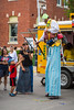 Lawrie the clown on stilts performing balloon sculpturing for the children at the Corn and Apple Festival 2016 in Morden, Manitoba, Canada.