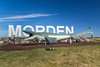 The City of Morden sign with Mosasaur Bruce replica at he east entrance to the city.