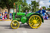 A vintage John Deere tractor at the 2016 Plum Fest street parade in Plum Coulee, Manitoba, Canada.