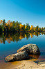 Autumn with reflections in Brereton Lake, Whiteshell Proviincial Park, Manitoba, Canada.