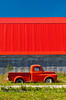 The color of red in a truck and barn roof near Niverville, Manitoba, Canada.