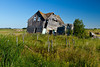 An old house in disrepair in rural western Manitoba, Canada.