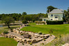 A large home with attractive landscaping on the Souris River in Souris, Manitoba, Canada.