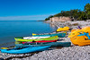 Colorful kayaks on the beach at Steep Rock, Manitoba, Canada.