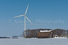 A windmill and a farm yard at the windfarm near St. Leon, Manitoba, Canada.
