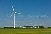 A windmill and farm yard at an electric windfarm near St. Leon, Manitoba, Canada.