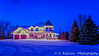 A large home illuminated at night near Winkler, Manitoba, Canada.