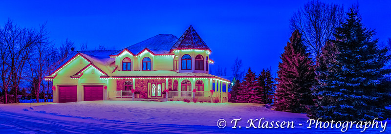A large home illuminaed at night near Winkler, Manitoba, Canada.