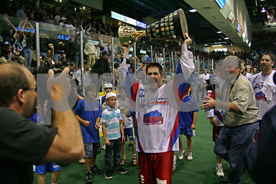 LP-10-2116-19-LRcrop copy  Mann Cup series MVP Shawn Evans takes a victory lap with the Cup after his Peterborough Lakers defeated the New Westminster Salmonbellies in game 6 at the Peterborough Memorial Centre.