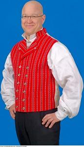 Mannsbunad fra Østfold. Vesten til Østfoldbunaden er laget i handvevet ull stoff med sølv knapper i klassisk femblads rosemønster