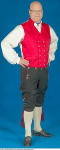 Herrebunad fra Rogaland med rød vest og ull strømper