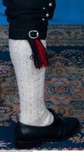 Mannsbunad fra Sogn med kvit jakke og kort bukse