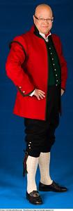 Mannsbunad fra Sogn med rød jakke og grønn vest og brodert linskjorte