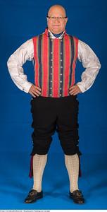 Mannsbunad fra Trøndelag med svart jakke og mansjett knapper i sølv