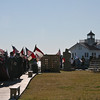 A bagpiper leads the Guilde of St. Andrew along the boardwalk, heading for Festival Park.
