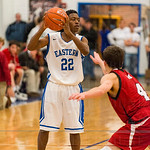 Tyler Green (22) looked for a team mate over the Manual defense.