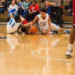 Eastern\'s Sugar Ray Wyche (2) and Caleb WIlliams (24) hit the floor to retain posession of the ball.