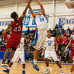 Caleb Williams (24) pulled down a rebound over Manual\'s Marquis McClendon (23).