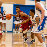 Dwayne Sutton (22) held off the close defense of Eastern\'s Dominique Knight (0).
