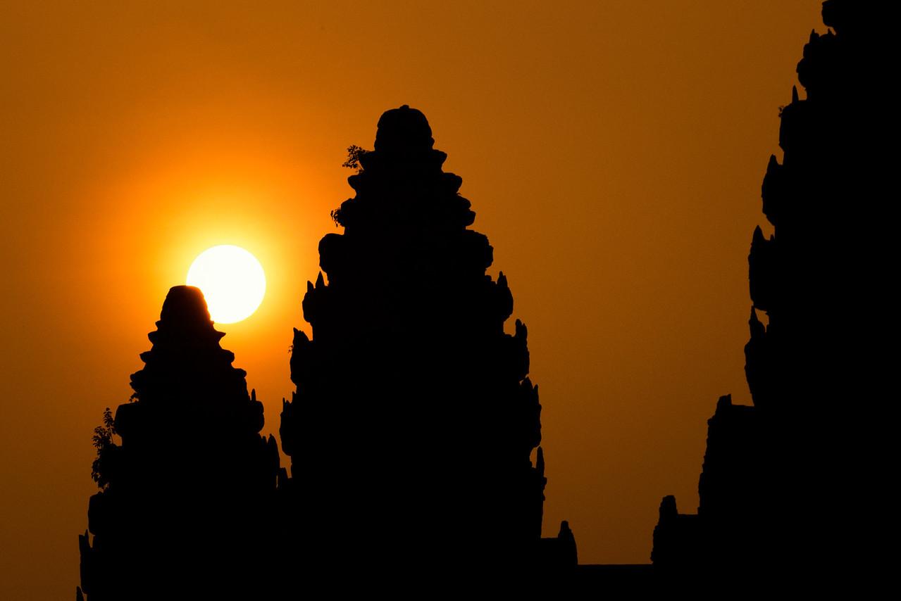 A hazy sunrise at Angkor Wat