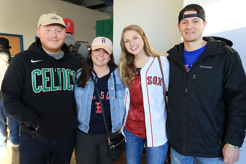 . The Red Sox World Series Parade was held on Wednesday morning in Boston. Many took the train from Fitchburg into Boston so they did not have to drive. Waiting for the train is Nolan David, Lindsay Connor From West Boylston, Jon Wirtanen from Westminster and Lindsay Connor from Westmionster. SENTINEL & ENTERPRISE/JOHN LOVE