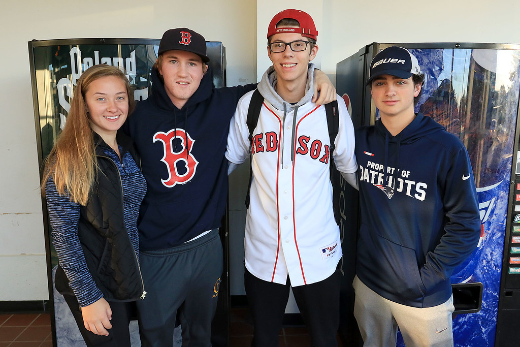 . The Red Sox World Series Parade was held on Wednesday morning in Boston. Many took the train from Fitchburg into Boston so they did not have to drive. Waitning for the train is Christine Jarowicz, 17, from Maine, Connor MacDonald, 18, from Maine, Ryan Estano, 17, from Brockton and Rocco Pucilli, 18, from Medford. SENTINEL & ENTERPRISE/JOHN LOVE