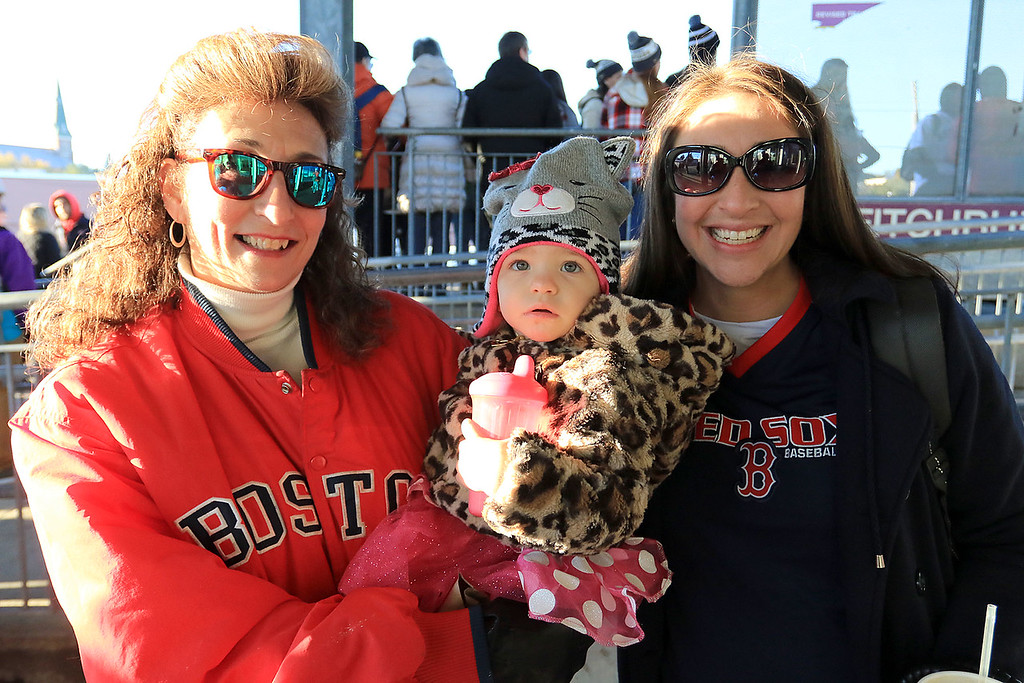 . The Red Sox World Series Parade was held on Wednesday morning in Boston. Many took the train from Fitchburg into Boston so they did not have to drive. Denise Pawelski, on left,with her daughter Andrea Milem and granddaughter Melody Milem, 2, wait for the train to Boston. SENTINEL & ENTERPRISE/JOHN LOVE