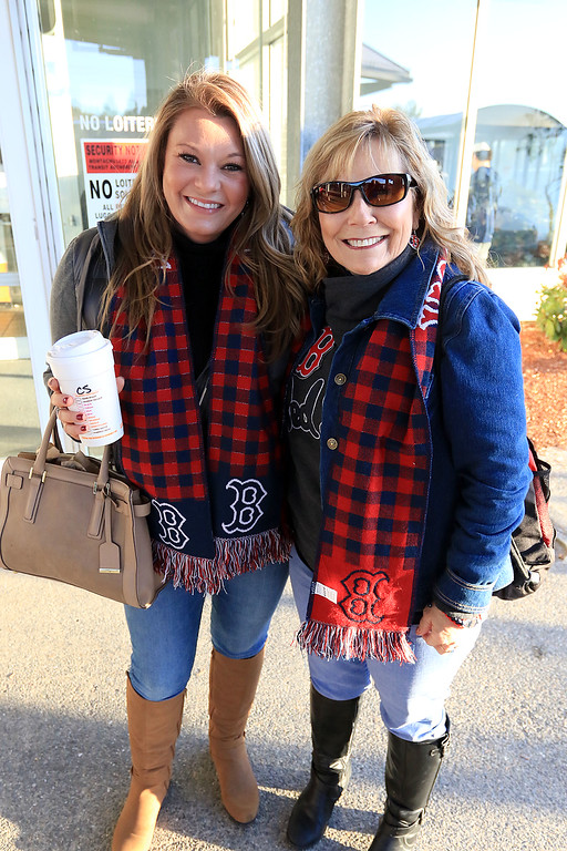 . The Red Sox World Series Parade was held on Wednesday morning in Boston. Many took the train from Fitchburg into Boston so they did not have to drive. Waiting for the train is Lindsay Hughes and Jayne Sambito of Fitchburg. SENTINEL & ENTERPRISE/JOHN LOVE