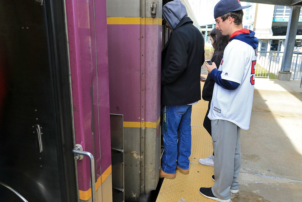 . The Red Sox World Series Parade was held on Wednesday morning in Boston. Many took the train from Fitchburg into Boston so they did not have to drive. People board the train wearing Red Sox gear. SENTINEL & ENTERPRISE/JOHN LOVE