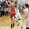 STAN HUDY - SHUDY@DIGITALFIRSTMEDIA.COM<br /> Maple Hills sophomore Paige Bleau lets another 3-point shot fly as Greenwich freshman Molly Brophy attempts to close in during their Class C preliminary game at Greenwich HIgh School. Feb. 20, 2018.