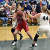 STAN HUDY - SHUDY@DIGITALFIRSTMEDIA.COM<br /> Maple Hill senior Tyalor Gerrain looks for an outlet as Greeenwich senior Gabby Wiss (22) and freshman Tess Merill (44) close in Tuesday night in Class C playoff action at Greenwich High Schoo. Feb. 20, 2018