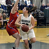 STAN HUDY - SHUDY@DIGITALFIRSTMEDIA.COM<br /> Greenwich junior Kylee Masse looks to get a shot off in front of Maple Hills' Emily VanApeldoorn in their Class C preliminary game at Greenwich HIgh School. Feb. 20, 2018.