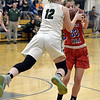 STAN HUDY - SHUDY@DIGITALFIRSTMEDIA.COM<br /> Greenwich senior Devin Drew is off her feet, fighting for an eventual jump ball with Maple Hill's Alysa Houghtaling in their Class C preliminary game at Greenwich HIgh School. Feb. 20, 2018.