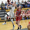 STAN HUDY - SHUDY@DIGITALFIRSTMEDIA.COM<br /> Maple Hill junior Alysa Houghtalingg looks to slow down Greenwich freshman Molly Brophy on her way to the basket during their Class C preliminary game at Greenwich HIgh School. Feb. 20, 2018.