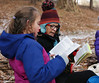 HOLLY PELCZYNSKI - BENNINGTON BANNER Fourth grade teacher Karen Thomson reads with her student Pernilla Borgia on Monday morning during an outdoor classroom set block. The outdoor classroom was created in 2018 for Maple Street Students for all areas of study. The trail is used by all the students at Maple Street School at least three times a week.