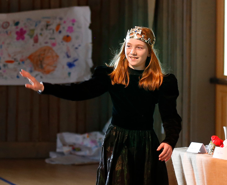 HOLLY PELCZYNSKI - BENNINGTON BANNER Sixth grader Clara Vickers waves to the crowd as she enters The medieval dinner which is held as a celebration to mark the end of a month long study of medieval times at Maple Street school in Manchester.