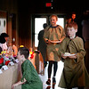 HOLLY PELCZYNSKI - BENNINGTON BANNER Fifth graders Luke Morin, Declan Donaldson and Anna Markcrou play the part of serf to sixth graders tand ake their orders during the medieval dinner on Thursday afternoon at Maple Street School in Manchester. The medieval dinner is a celebration held at the end of a month long study of medieval times.