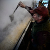 KRISTOPHER RADDER - BRATTLEBORO REFORMER<br /> Jerry Smith, of Deer Ridge Farm, in Guilford,  checks out the syrup as it boils on Monday, Feb. 26, 2018.